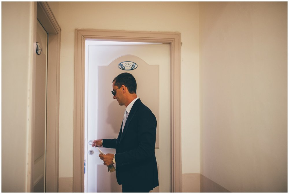 Groom gets ready for his Italian wedding in Santa Maria Di Castellabate.