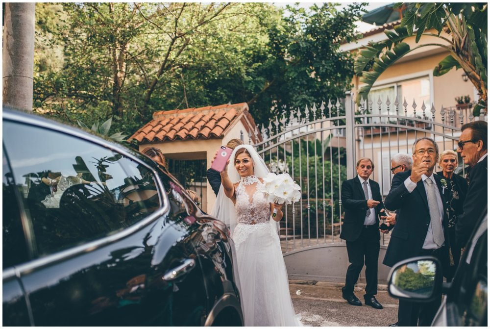 Beautiful Italian bride takes a selfie on her wedding day.