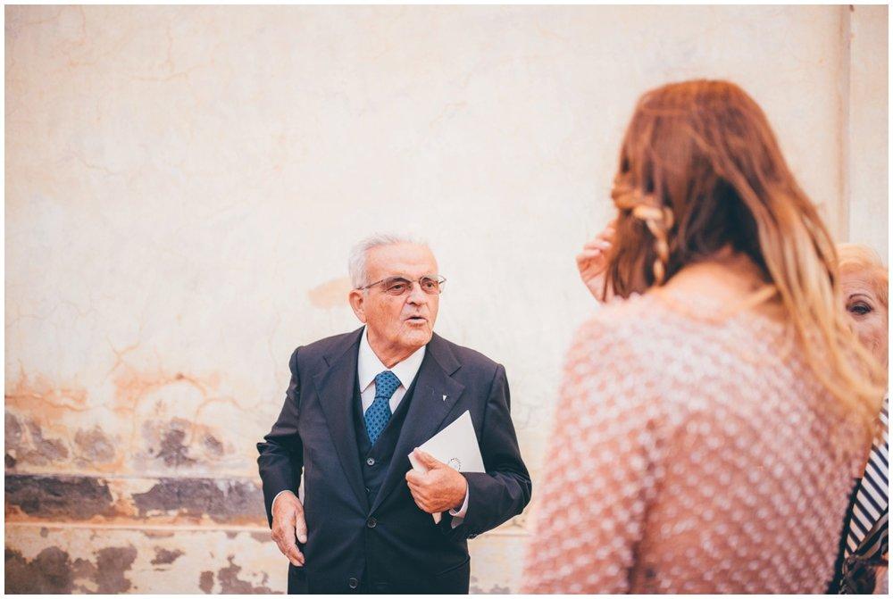 Cute Italian man greets guests.