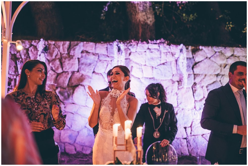 Bride enjoys her Italian wedding meal.