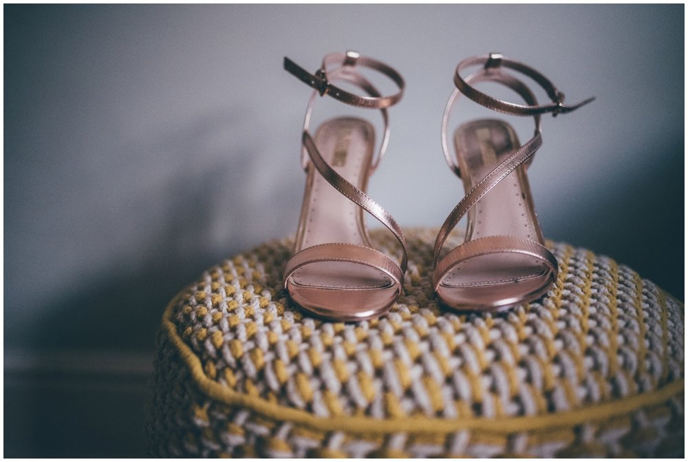Beautiful rose gold bridal shoes for New Years Eve wedding.