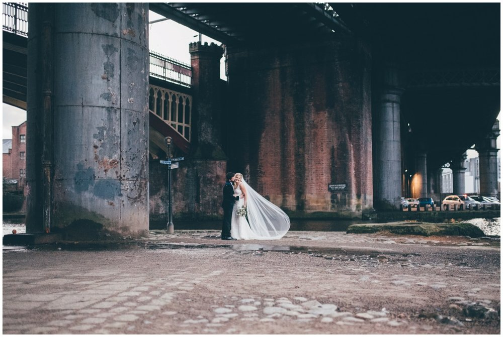 New Years Eve bride and groom pose for their wedding photographs in Castlefield, Manchester City Centre.