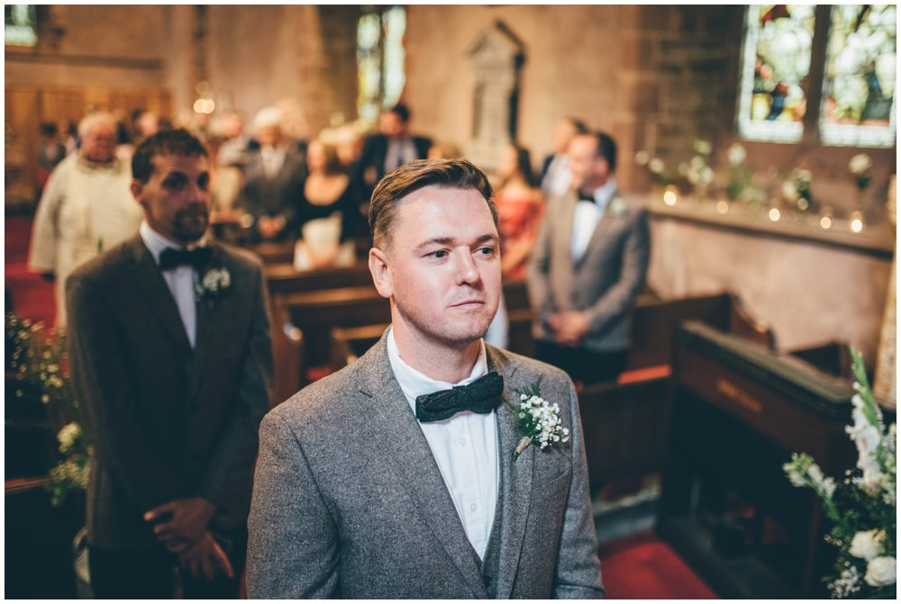 The groom waits for his bride to arrive at St. Matthews church in Leek, Staffordshire.