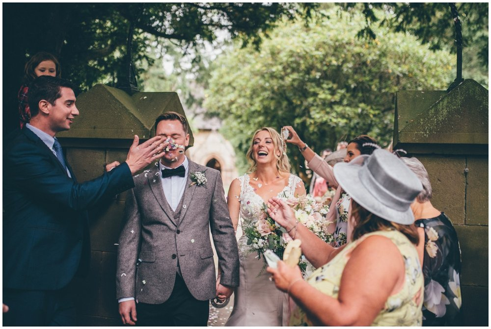 Wedding guest throws confetti in the groom's face after their wedding at St. Matthews church in Leek.
