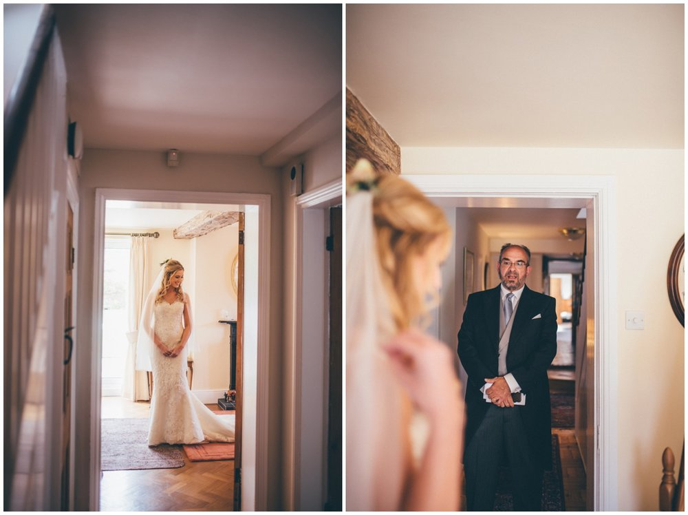 Bride's parents see her dressed and ready for the first time.