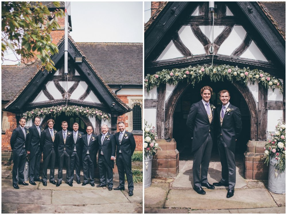 Groom and his groomsmen pose for some photographs outside St Mary's church in Cheshire.