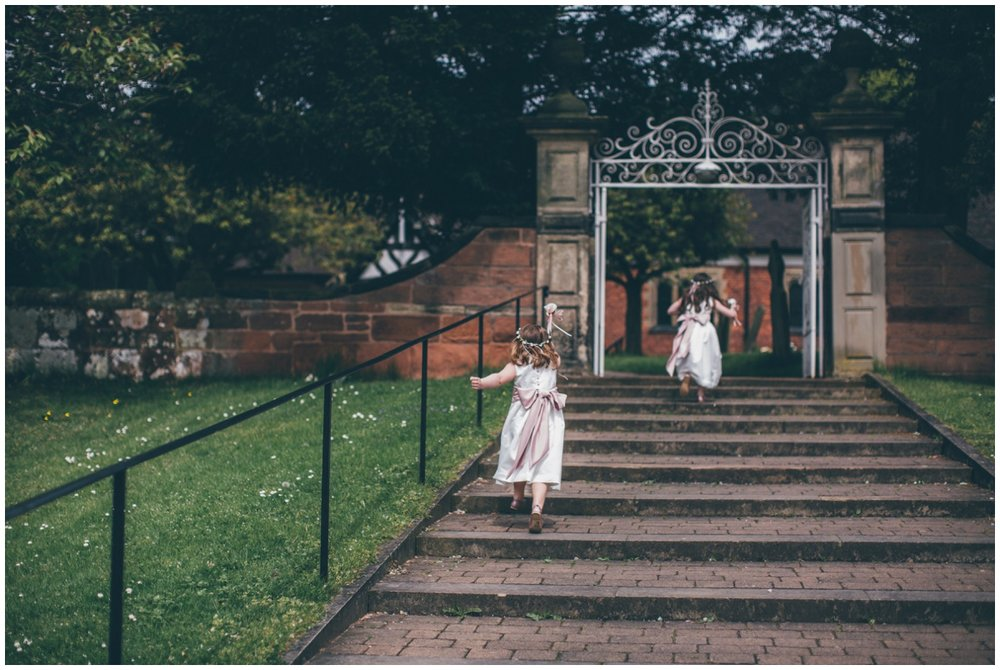 Adorable little flowergirls run into St Mary's church in Cheshire ahead of the bride.