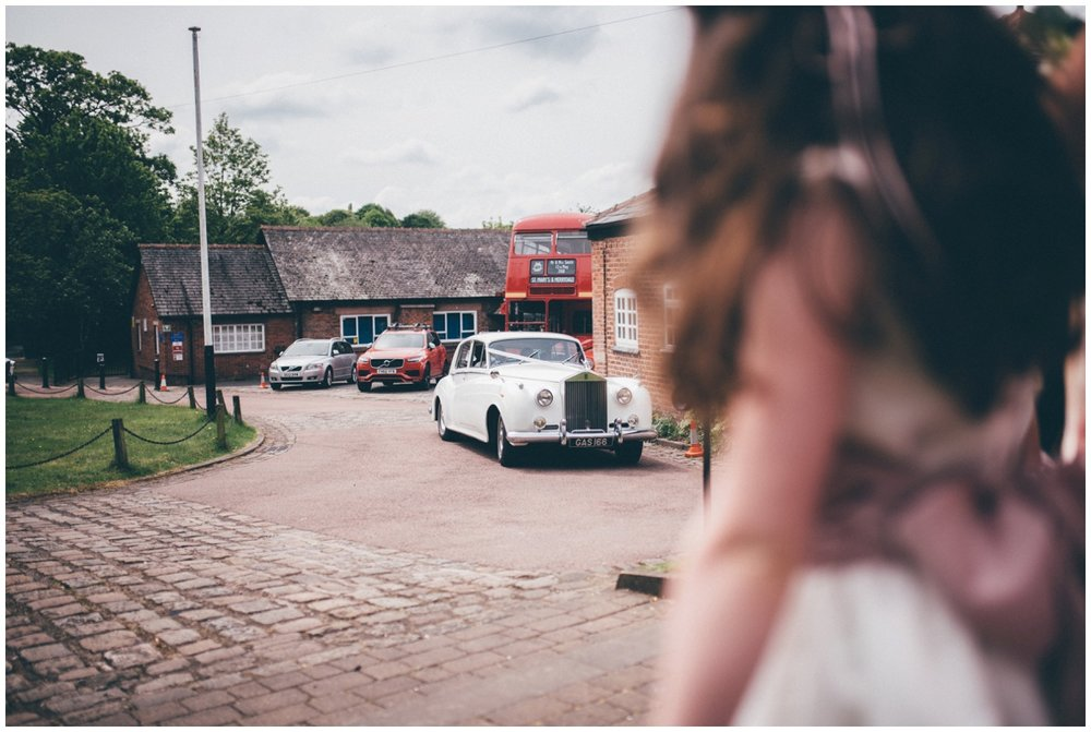The bride arriving at St Mary's church in Cheshire in a vintage wedding car.