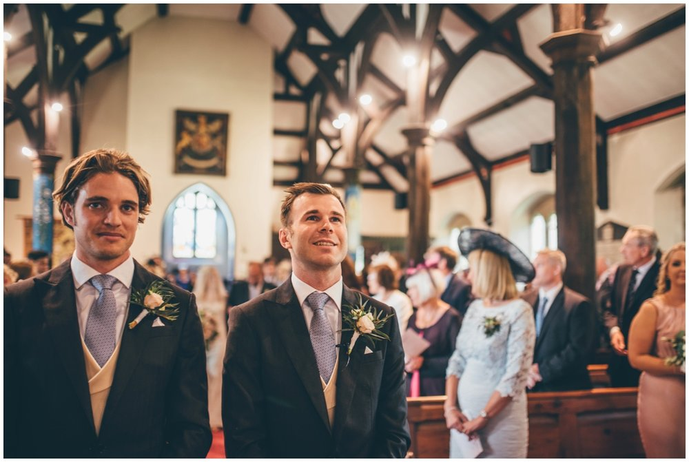 Groom and Best Man wait for the bride to arrive in St Mary's Church in Cheshire.