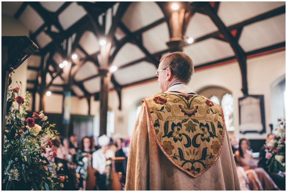 The vicar leads the wedding service in St Marys Church in Cheshire.