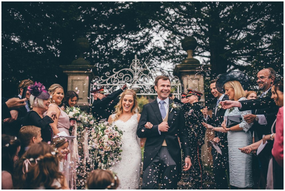 Wedding guests all throw confetti at the bride and groom outside St Mary's Church in Cheshire.