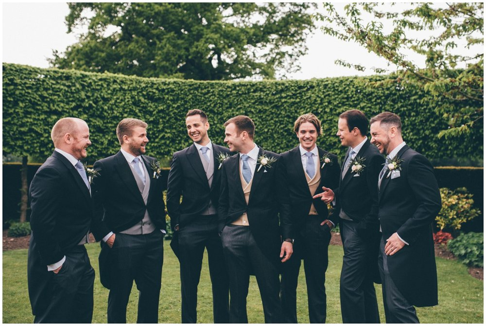 Groomsmen all share a joke in the grounds of Merrydale Manor.