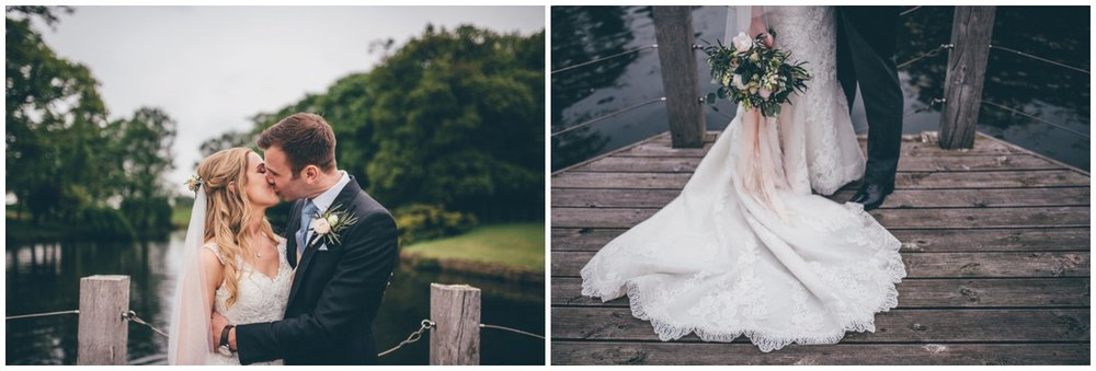 Bride and groom at Merrydale Manor have their wedding photographs taken on the jetty.