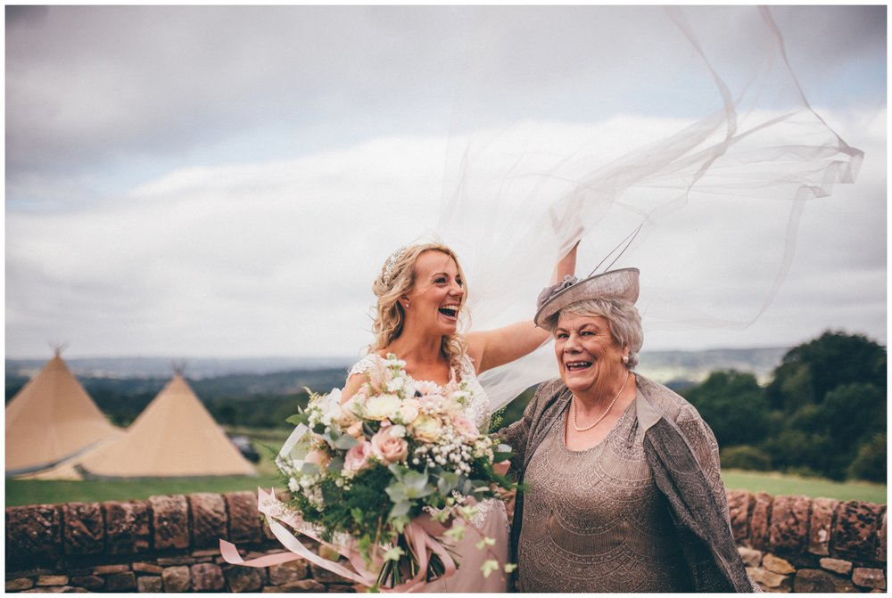 Bride loses he veil whilst stood with her mum before her tipi wedding in Staffordshire.