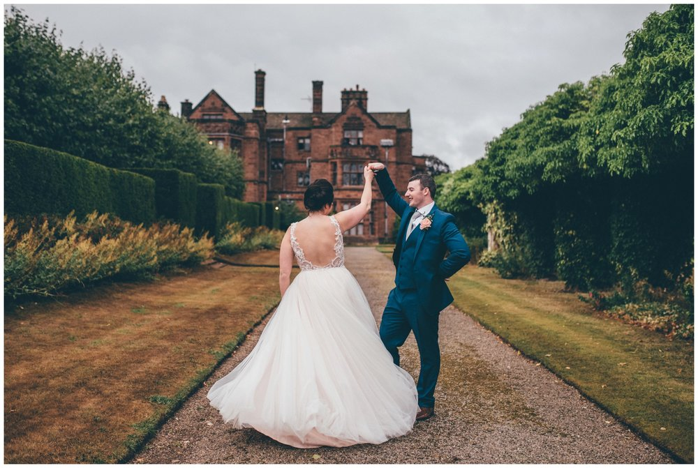 The newlyweds practise their First Dance in the grounds of Thornton Manor at their Wirral Wedding.