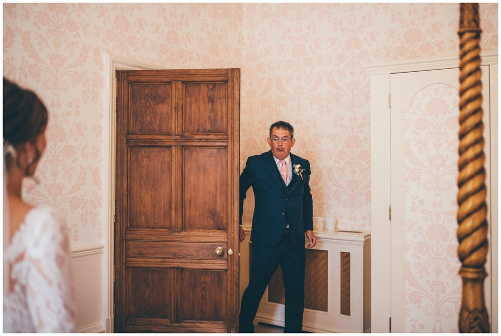 Father of the bride sees his daughter I her wedding dress for the first time at Tilstone House in Cheshire.