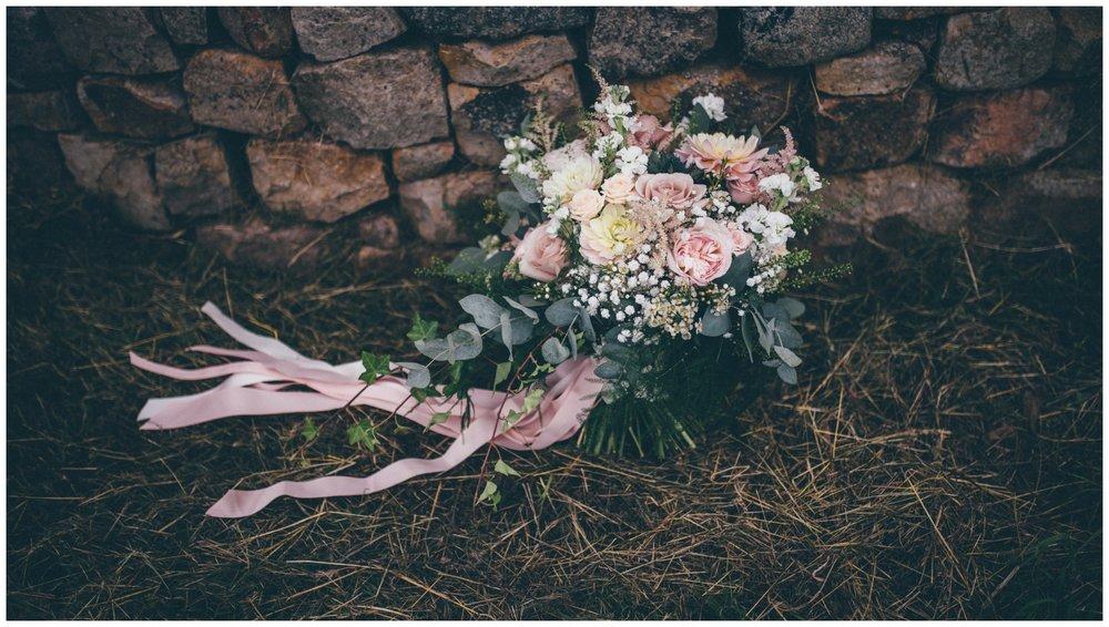Stunning pastel bridal bouquet with ribbons.