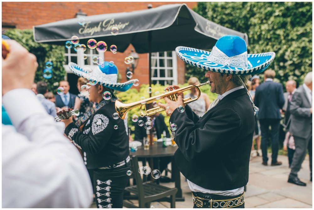 Bride and groom hire a mariachi band for their summer wedding at Nunsmere Hall, in full sombreros.