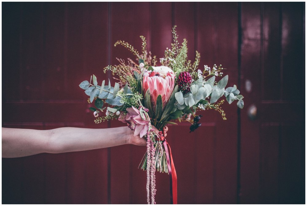 Incredible wild wedding bouquet held by the bride The Hide in Sheffield.