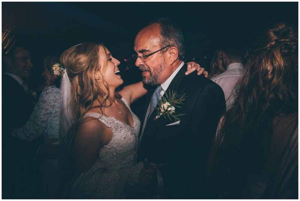 Bride dances with her dad at Merrydale Manor.