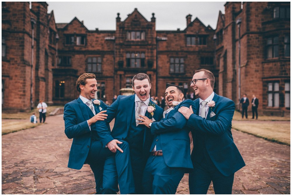 Groomsmen and the groom have fun at Thornton Manor wedding in the summer.