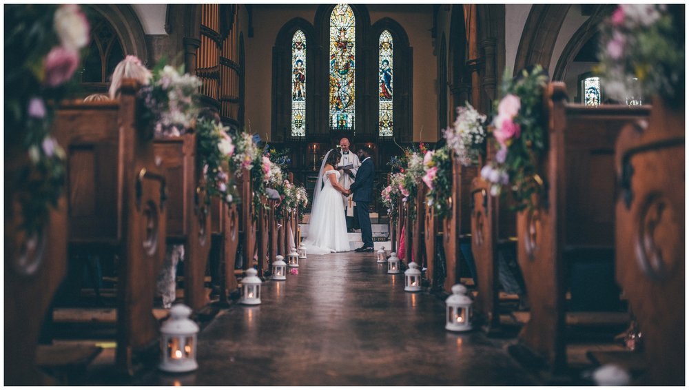 Beautifully flower filled church for a wedding in Essex.