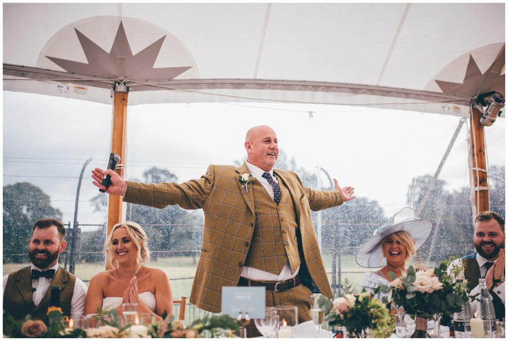 Father of the bride reads his speech at Swinton Park Estate.
