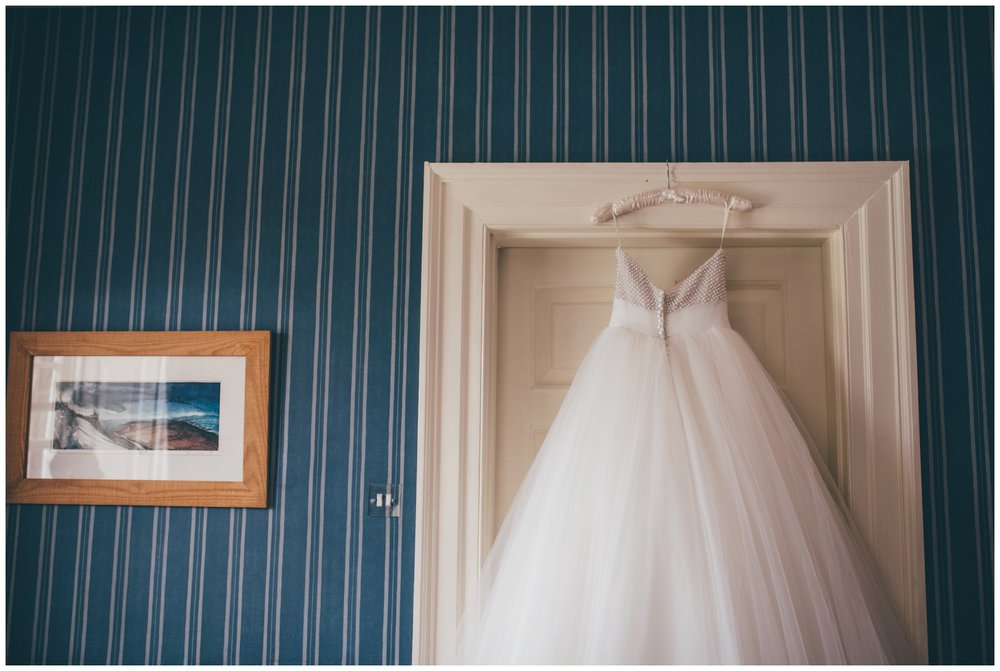 Stunning Ronald Joyce beaded gown, hung up in the bridal suite at Swinton Park Estate in Yorkshire.