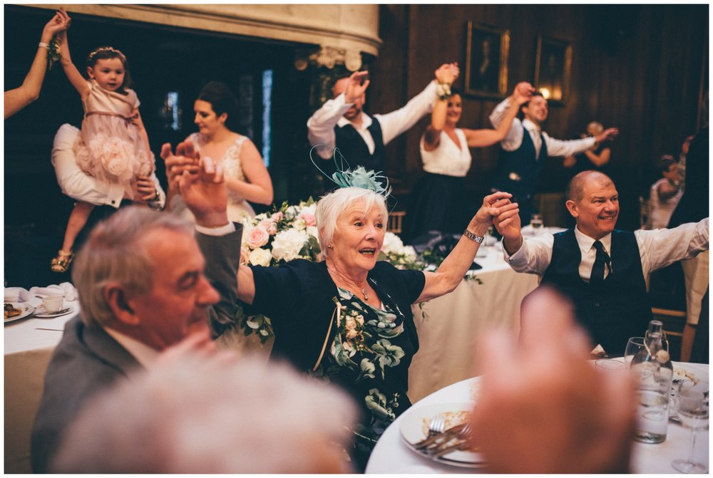 The singing waiters at Thornton Manor wedding get all the wedding guests dancing during the meal and speeches.