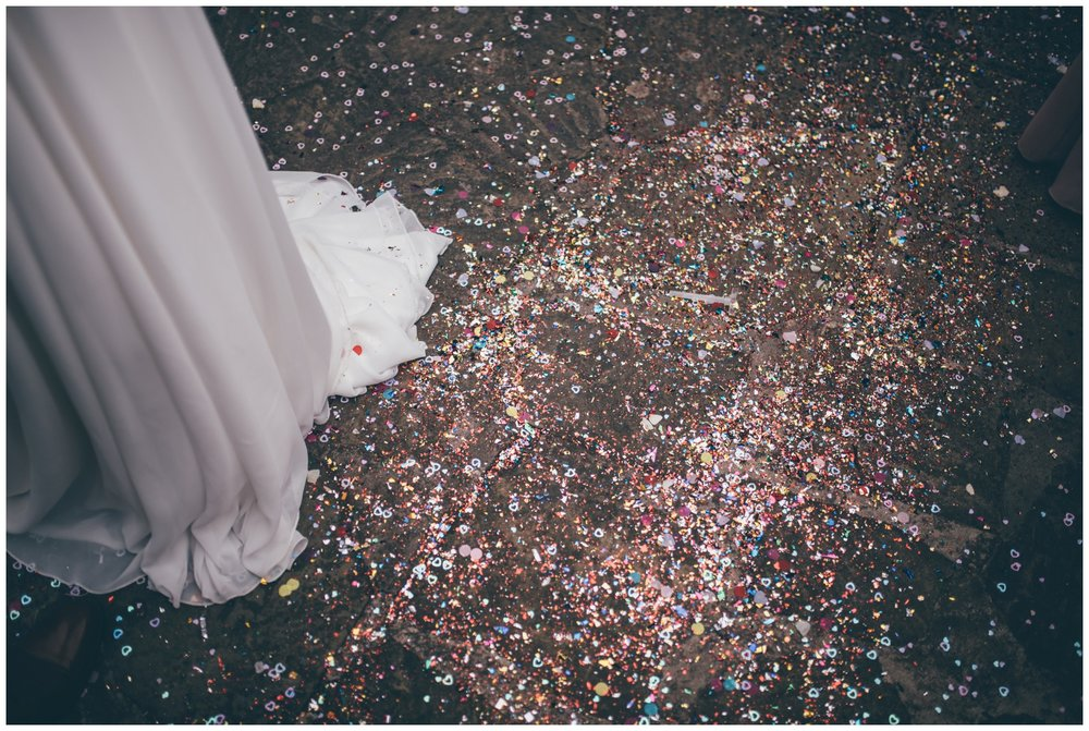 The bride has metallic confetti and glitter for her wedding which went everywhere at Trafford Hall!
