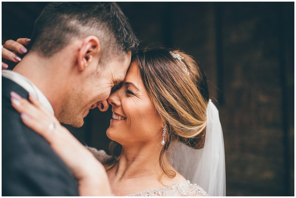 Bride and Groom snuggle together at their Disney themed Peckforton Castle wedding.