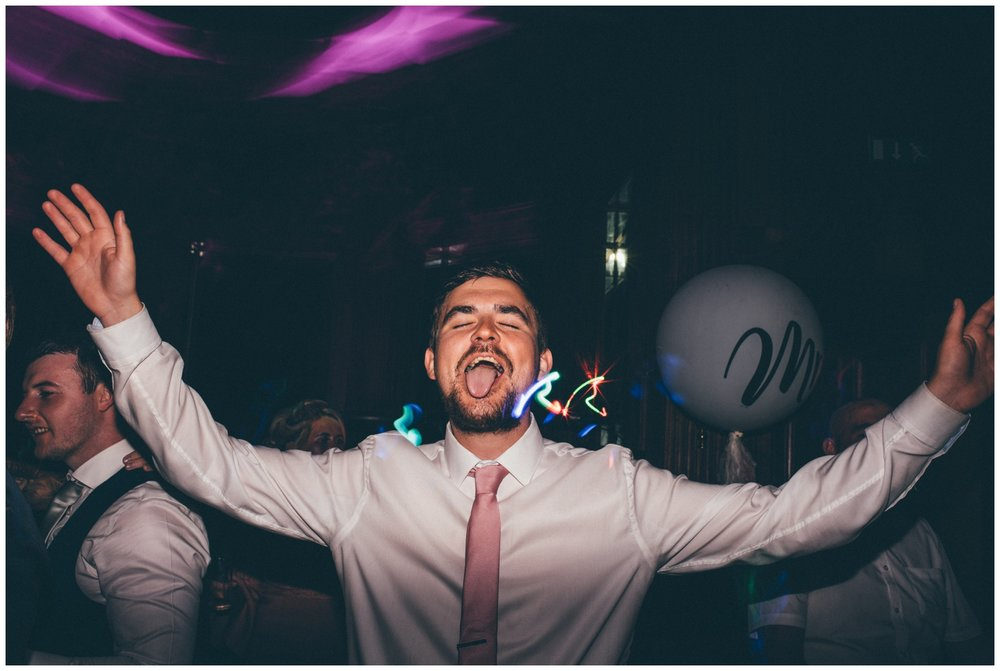 Hilarious wedding guest on the dance floor.