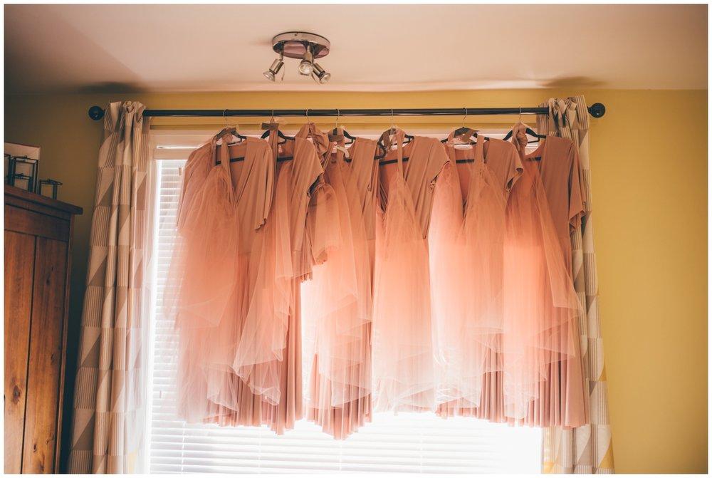 The custom-made dusky pink bridesmaids dresses.