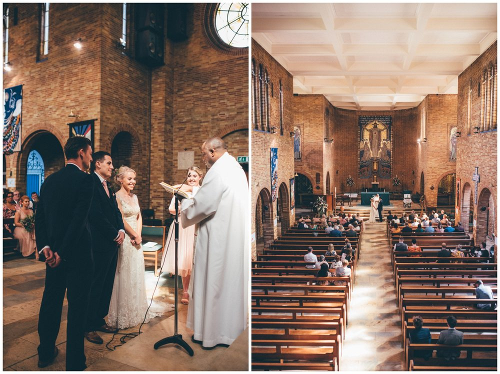 Bride and groom do their vows at Sacred Heart Church in Sheffield.
