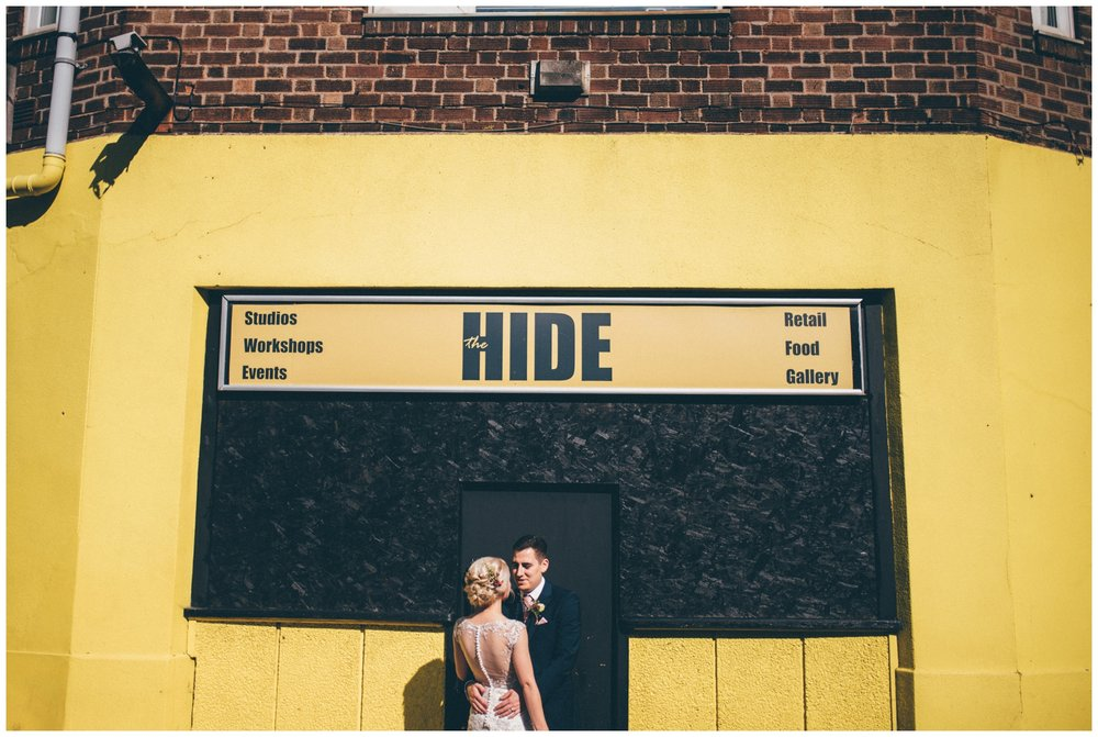 Bride and groom stand outside The Hide, their Sheffield city centre wedding venue.