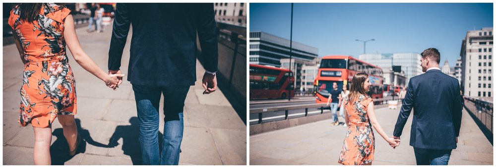 Couple stroll through London City Centre for their engagement shoot.