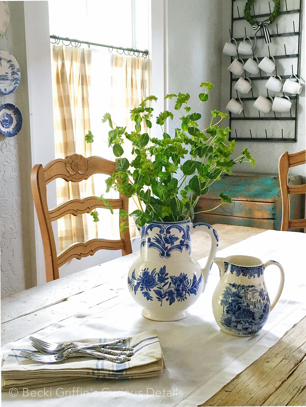 Detail of dining table styling with classic blue and white pitchers.