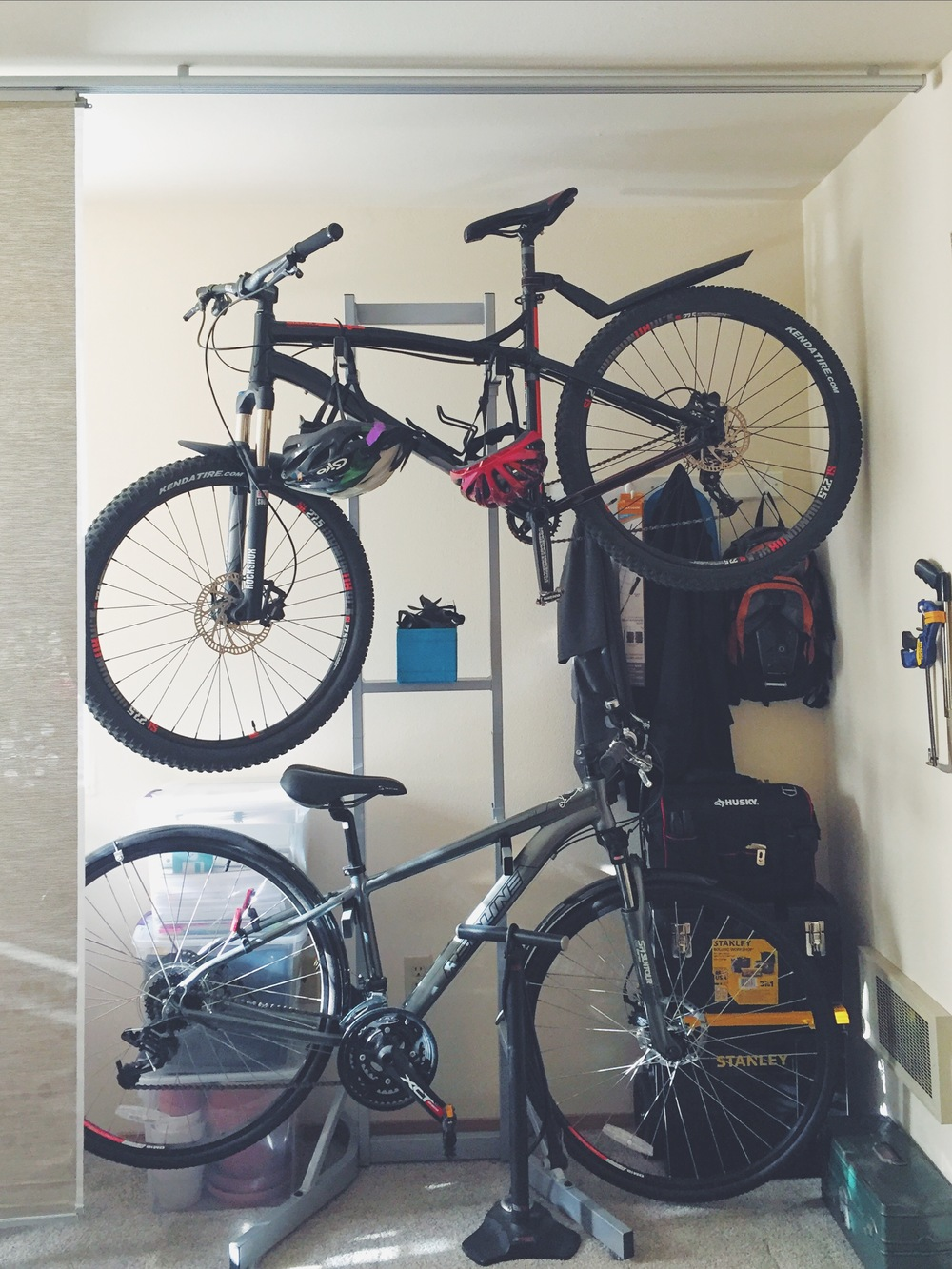 Bike shed ... open. These screens are light and easy to pull. A great solution for hiding stuff you need to access often but don't want to look at all the time ...