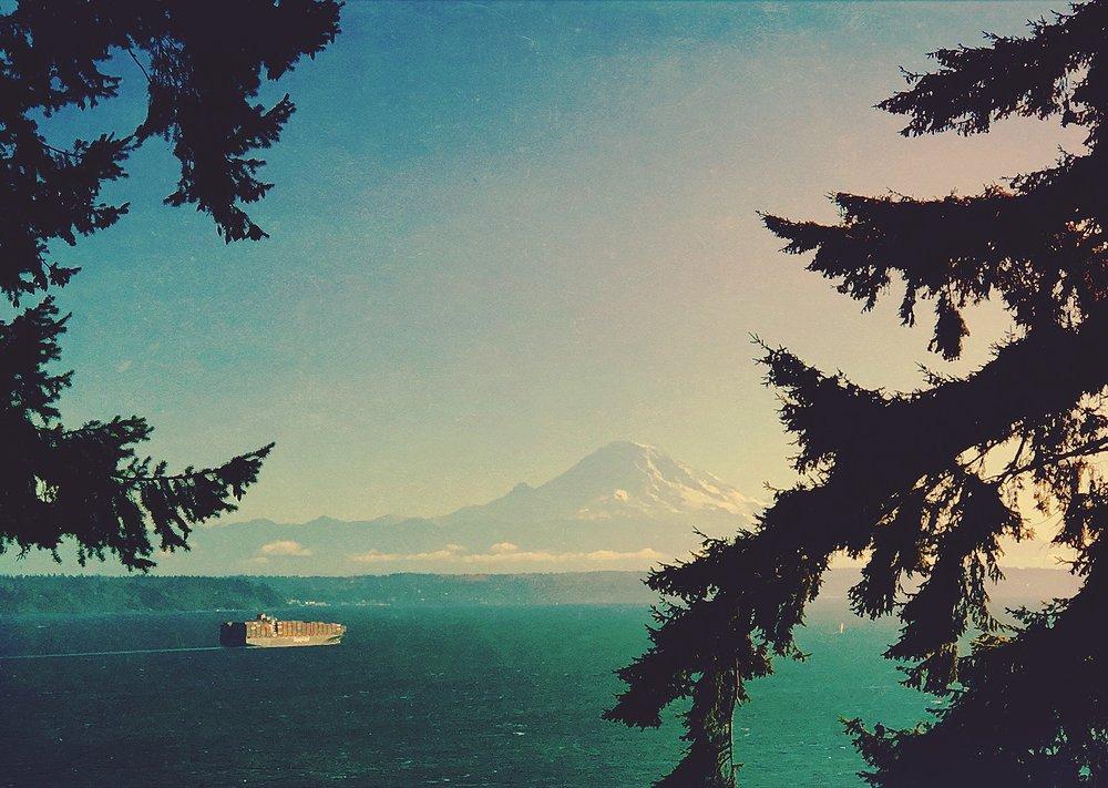 A freighter chugs toward Mount Rainier ....