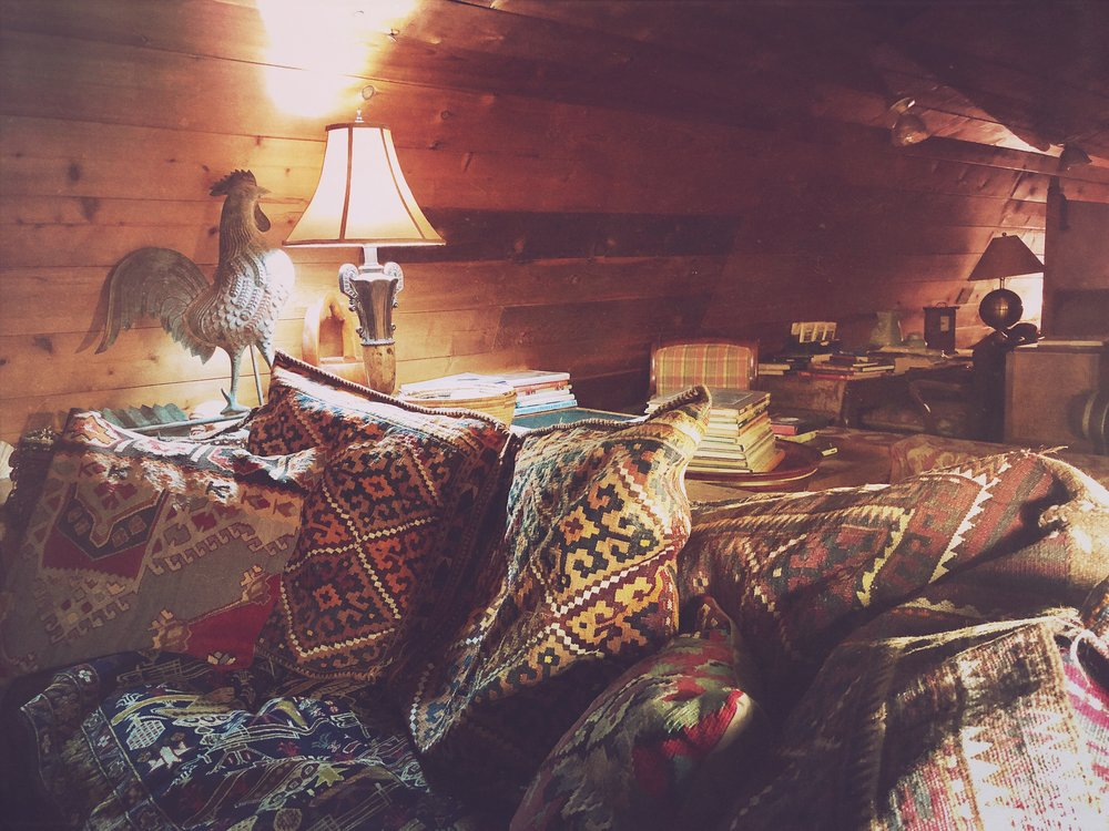 The Loft is a nest of Pendleton rugs and pillows, repurposed wood interiors, and books, books, books!