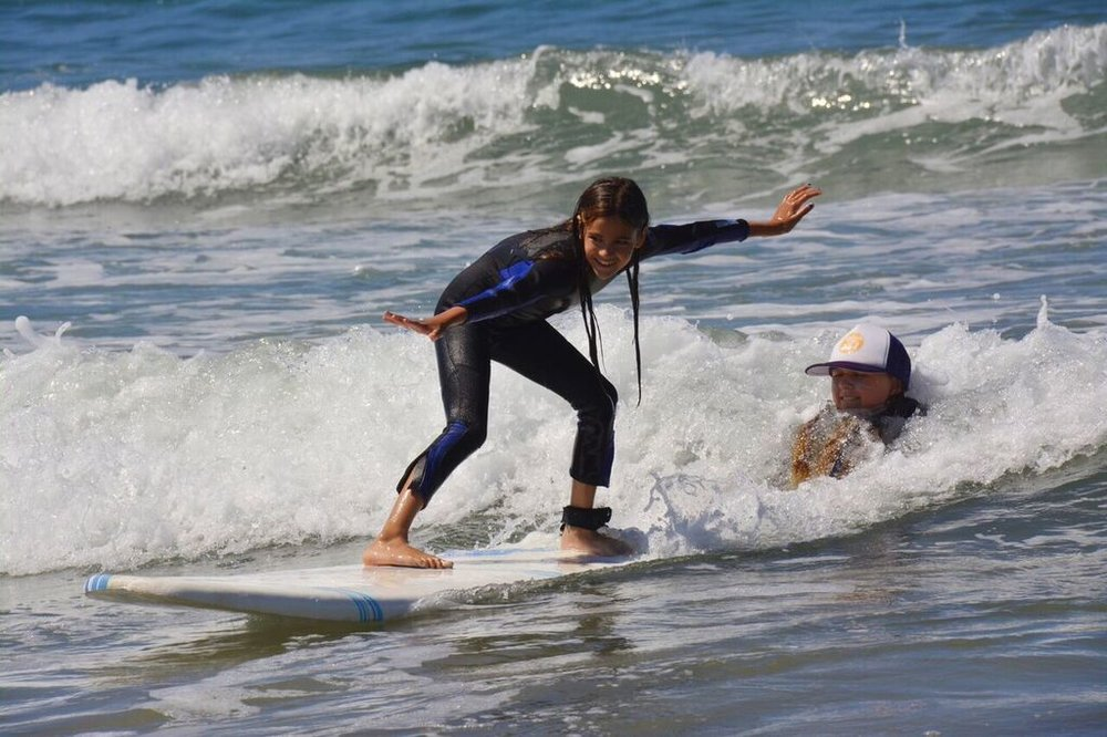 Learning to surf with instructor.jpeg