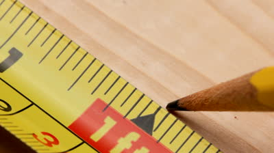 stock-footage-tape-measure-on-wood