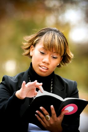 black woman reading Bible