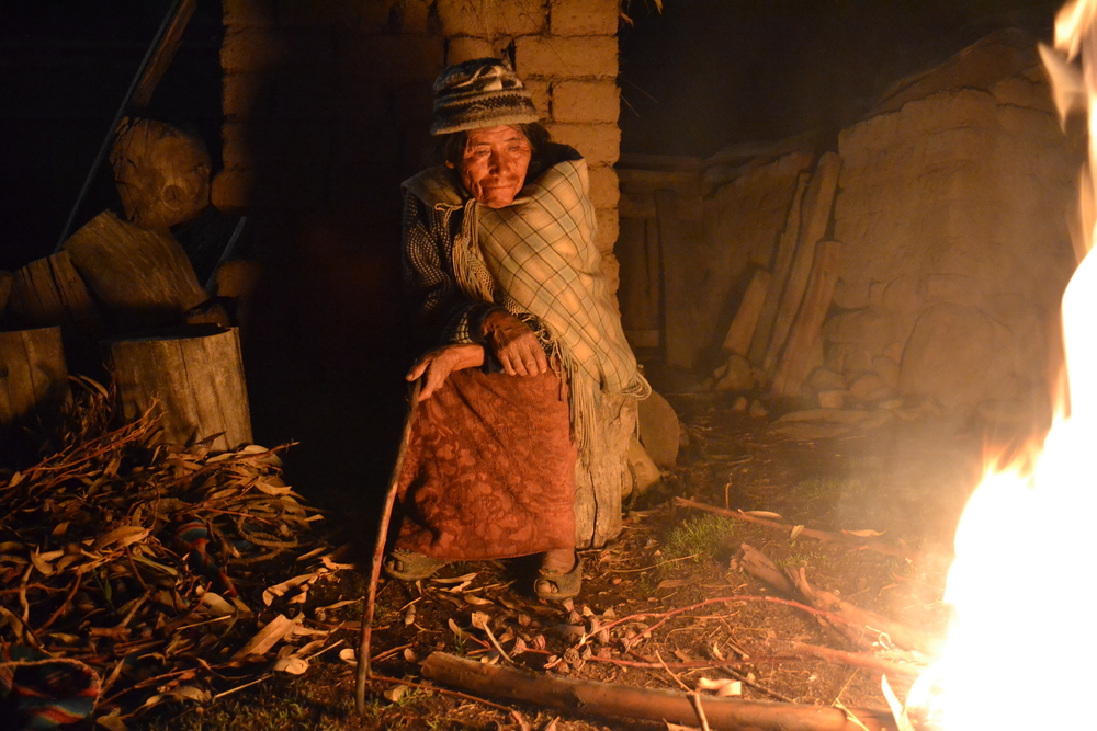 An Aymara woman I stayed with tends her fire. Bolivia, 2015. Photo: Owen Liu
