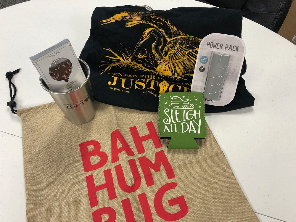 Ugly Sweater Contest Prize: CCJ tshirt and clean kanteen mug, peppermint chocolate, portable power pack, holiday coozie, and Bah Hum Bug gift bag.