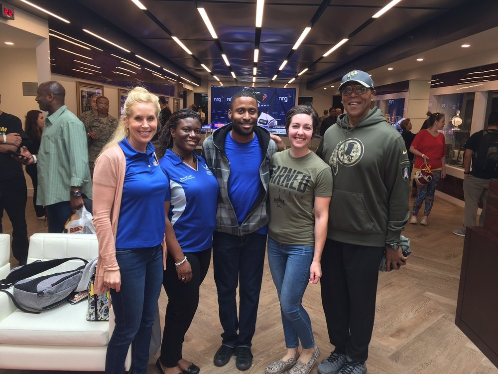 From left: AFA Wounded Airman Program Staff, Whitney Distaso;Air Force Wounded Warrior Program Staff, Theda Franklin;SSgt Raphael Holmes and SSgt Jessica Gutierrez and AFA President, Gen Larry Spencer at the Redskins Salute May 20, 2017.