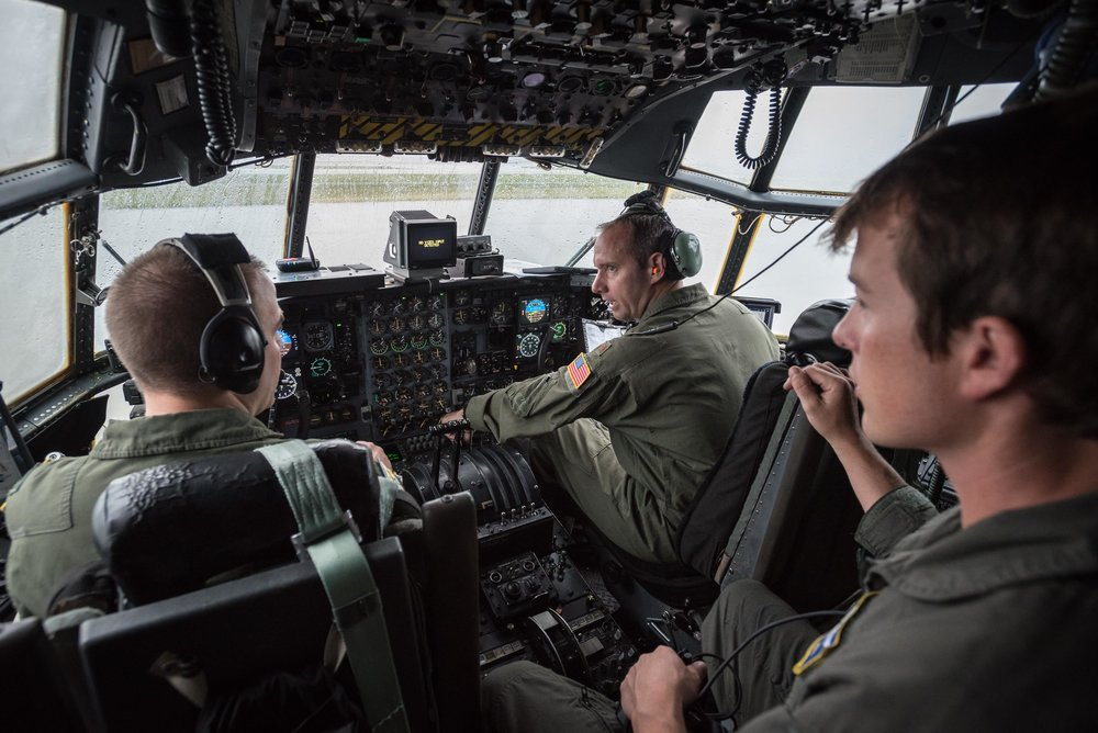 Aircrew members from the 123rd Airlift Wing prepare to fly to Texas aboard a C-130 Hercules at the Kentucky Air National Guard base in Louisville, Ky., Sept. 1, 2017. The Airmen will fly humanitarian aid and airlift evacuation missions there in the aftermath of Hurricane Harvey. USAF Photo.