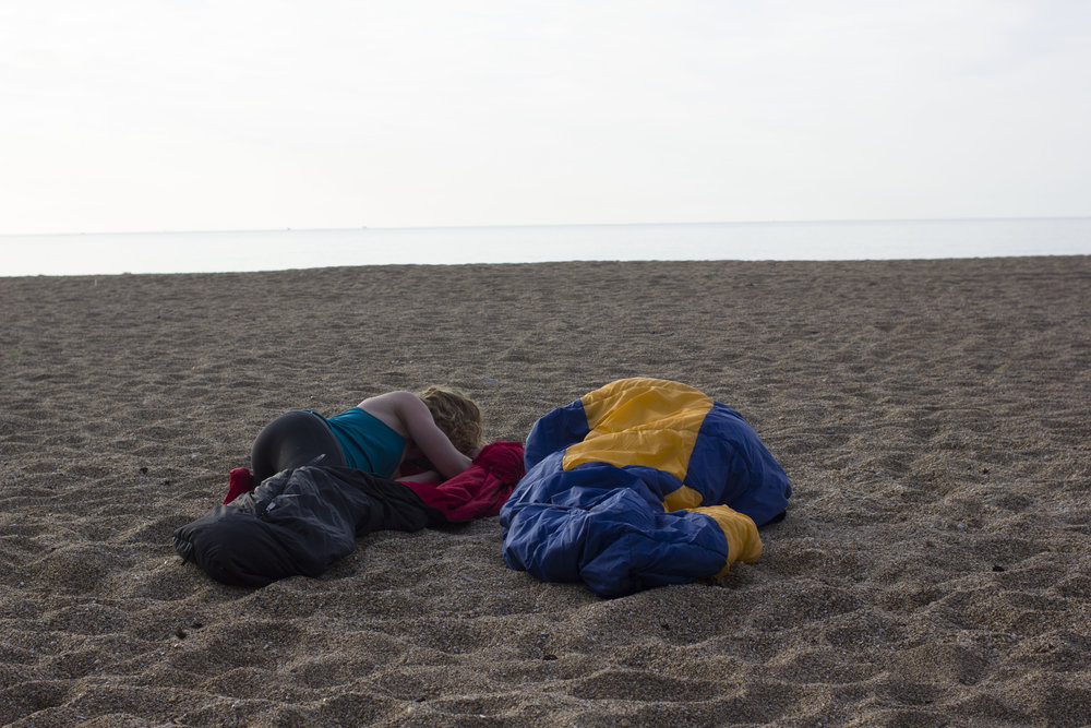 Asleep during a kayak beach camping trip in Devon_credit DannyBent.com