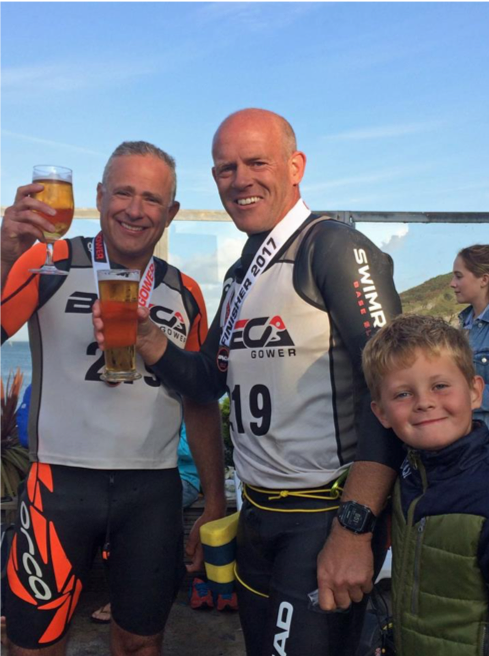 Breca Gower swimrun finish line beer