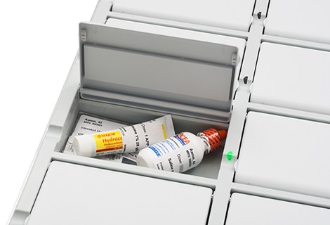 Medicine containers in an open Omnicell XT storage compartment.